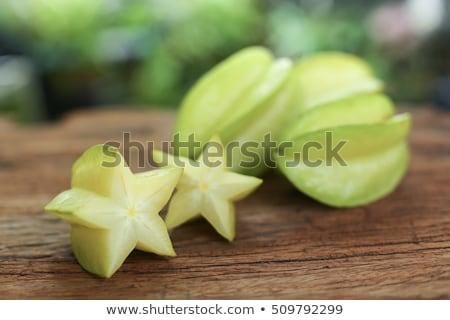 Star fruits on wooden table. Thai fruit : Star fruit is popular in asia, sweet taste fruits. Star fr Stock photo © galitskaya