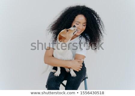 Sevimli mutlu kadın kıvırcık saçlı öpücük jack russell terrier Stok fotoğraf © vkstudio