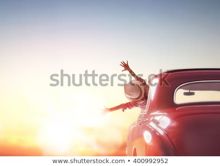 woman is relaxing and enjoying road trip Stock photo © choreograph