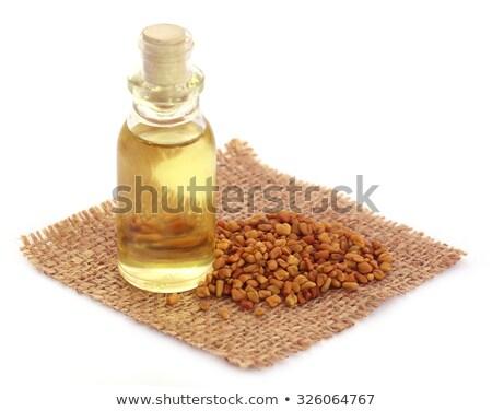 Magok olaj üveg zöld levelek fából készült felület Stock fotó © bdspn