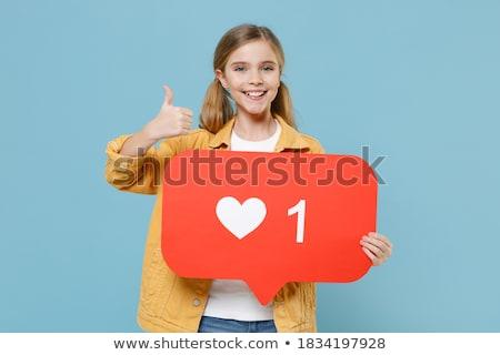 red haired teenage girl holding heart icon Stock photo © dolgachov