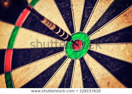 Stock photo: Dartboard with Black Arrow in Bullseye and Aim