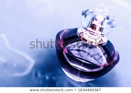 Perfume bottle under purple water, fresh sea coastal scent as gl Stock photo © Anneleven