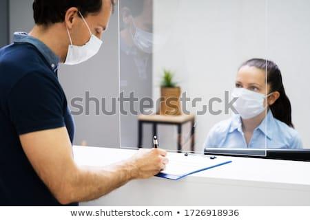 Client signature papier réception bureau visage Photo stock © AndreyPopov