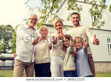 mother, daughter and grandmother showing thumbs up Stock photo © dolgachov