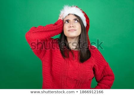 beautiful brunette woman put on santas hat Stock photo © Rob_Stark