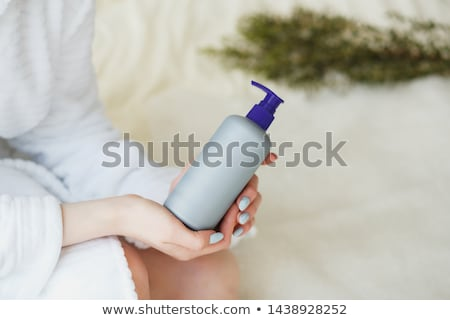 Body care - woman holding shampoo stock photo © CandyboxPhoto