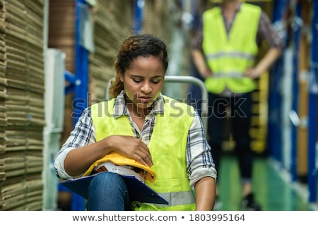 Stressed young factory worker Stock photo © photography33