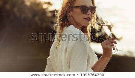 женщины питьевой шампанского счастливым портрет говорить Сток-фото © photography33