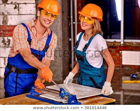 Young woman cutting a tile Stock photo © photography33