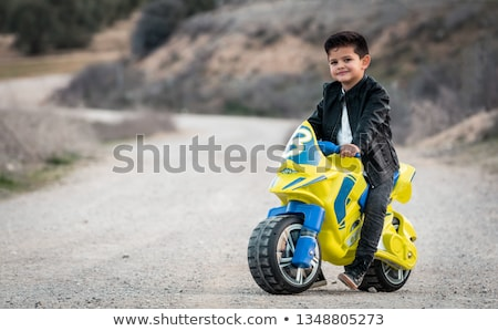 Child on a toy motorcycle Stock photo © photography33