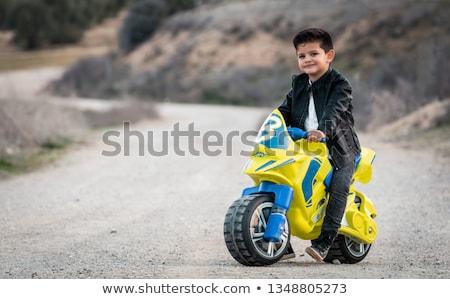 Criança brinquedo motocicleta de volta jovem pé Foto stock © photography33