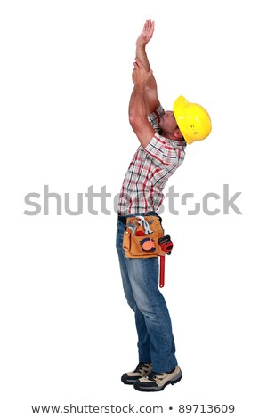 Laborer trying to touch the ceiling, studio shot Stock photo © photography33