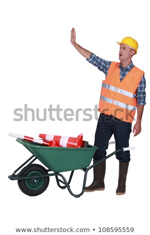 Builder making stop gesture whilst stood with traffic cones Stock photo © photography33