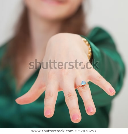 Woman shows new ring with blue gem Stock photo © pzaxe
