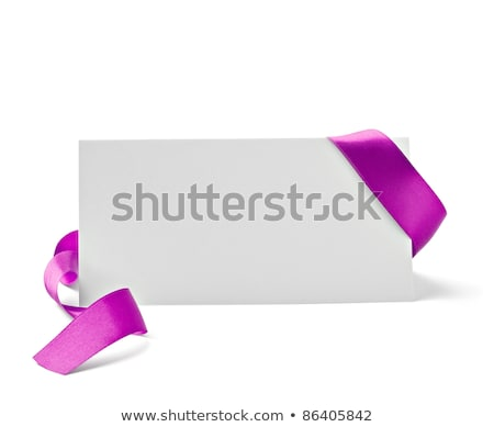 close up of card note with purple ribbon on white stock photo © shutswis