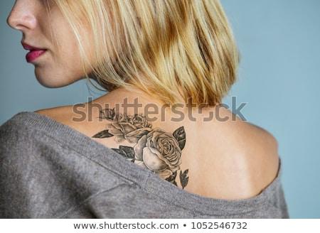 Retour tatouage femme robe rouge séance mer Photo stock © ssuaphoto