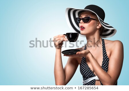 elegant fashion lady with cup of tea stock photo © carlodapino