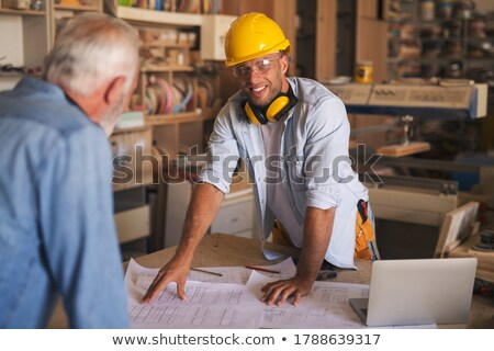 craftsman holding a blueprint and a toolbox Stock photo © photography33
