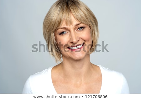 portrait of a trendy middle aged woman stock photo © stockyimages