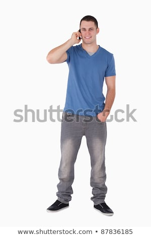 Portrait of a young man making a phone call against a white background Stock photo © wavebreak_media