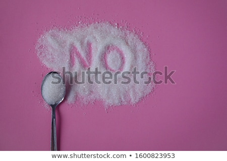 Spoon with sugar against white background Stock photo © wavebreak_media
