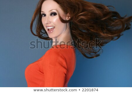 Stock photo: Glamorous Woman Tousling Her Hair