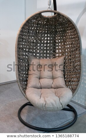 The art of rattan armchair with cushion and softness of the seat Stock photo © JohnKasawa