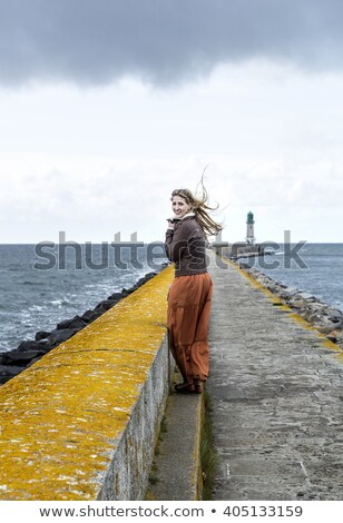pretty young woman looking at the ocean in a romantic way stock photo © photocreo