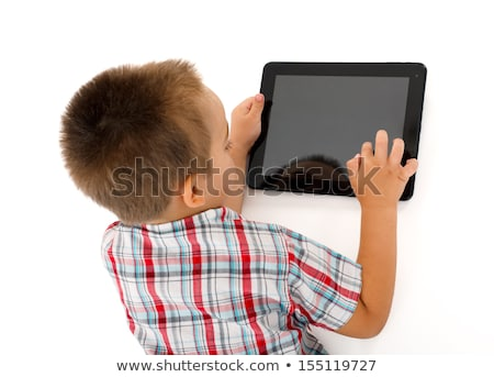 Wise little boy with tablet pc Stock photo © icefront