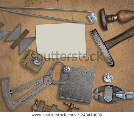 diamonds and tweezers on a jeweler anvil Stock photo © RedDaxLuma