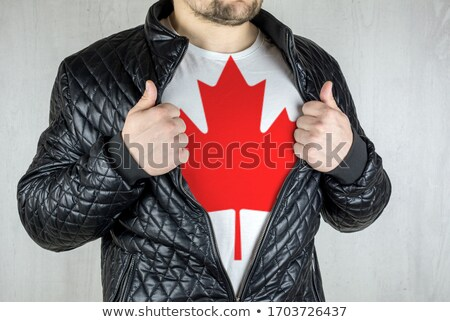 Man stretching jacket to reveal shirt with Canada flag Stock photo © stevanovicigor