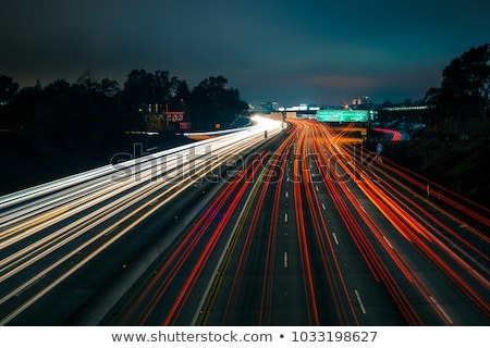 Fast moving cars at night time Stock photo © Nejron