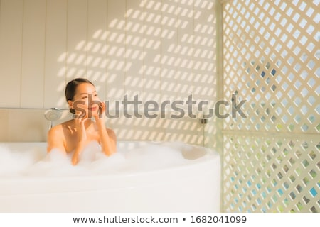 Foto d'archivio: Beautiful Young Woman Taking A Bubble Bath