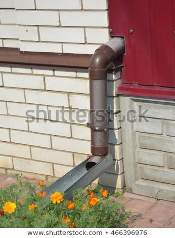 Rain gutter draining pipe water away from home Stock photo © nalinratphi
