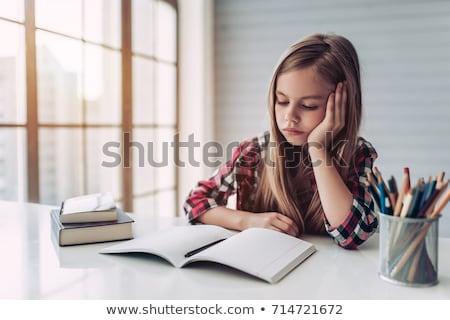 Iskolás lány ül asztal néz unatkozik földgömb Stock fotó © stryjek