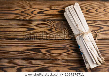 roll of newspapers tied with a rope stock photo © cipariss