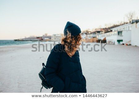young fashion woman looking down with her hands in pocket Stock photo © feedough