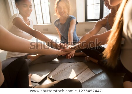 Young cheerful fit woman sitting on the yoga mat Stock photo © deandrobot