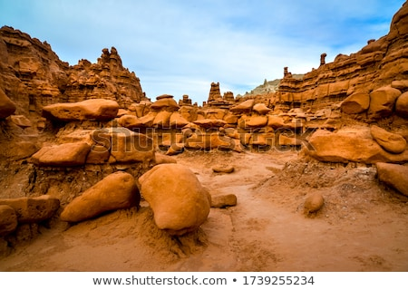 mushroon shaped hoodoo with chimney goblin valley state park roc stock photo © billperry