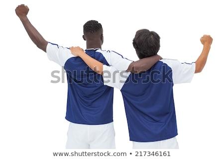 Futballista kék ünnepel győzelem fehér boldog Stock fotó © wavebreak_media