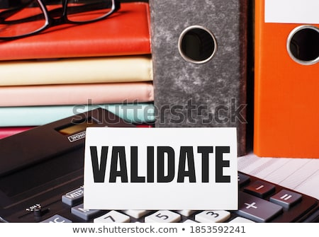 red office folder with inscription assessments stock photo © tashatuvango