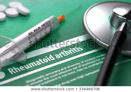 rheumatoid arthritis medical concept on green background stock photo © tashatuvango