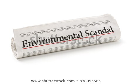 Rolled newspaper with the headline Environmental Scandal Stock photo © Zerbor