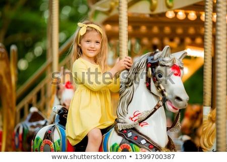 children on carousel stock photo © paha_l