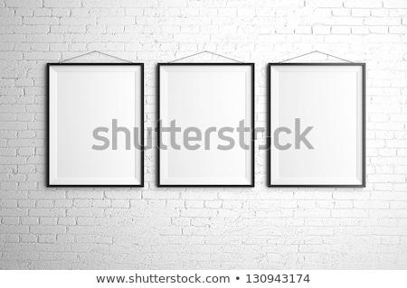 Stock photo: three blank frames on grey brick wall