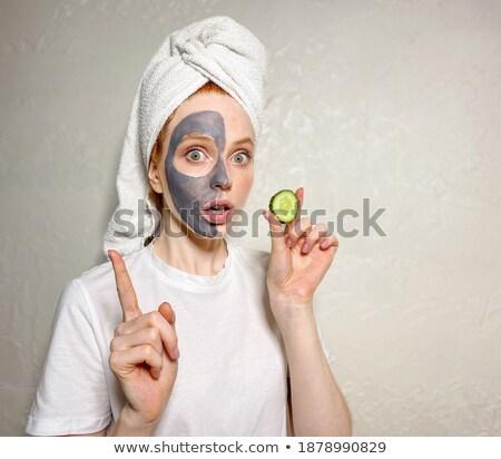 Attractive woman having cucumber on her face Stock photo © wavebreak_media