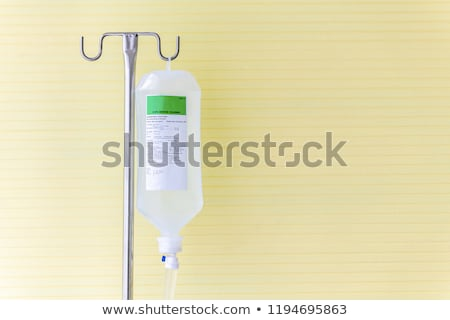 Infusion bottle with saline solution for patient in hospital roo Stock photo © FrameAngel
