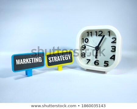 Clock and word Marketing Stock photo © fuzzbones0