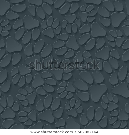 A lot of dog's paw prints on dark gray background. Stock photo © almagami